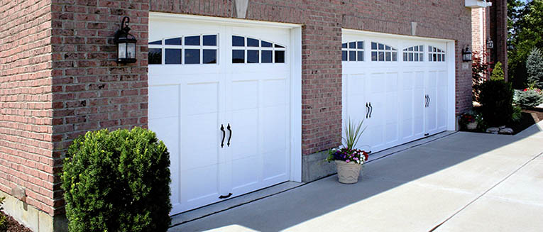 Carriage garage doors settlers collection steel for Carriage style garage doors for sale